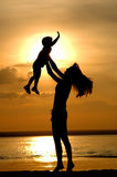 Silhouettes of the women and child Stock Image
