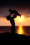 Silhouettes of women and a child Stock Photo