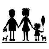 Silhouettes of women and dogs. Stock Photos