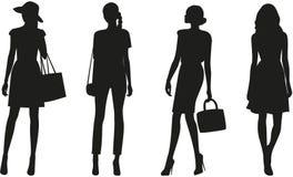 Silhouettes of women. Silhouettes of fashion women on white background Royalty Free Stock Photo