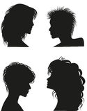 Silhouettes of women hairstyles. Stock Images