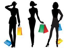 Silhouettes of women with shopping. Royalty Free Stock Photography