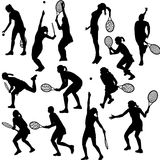Silhouettes of the women who play tennis Royalty Free Stock Images
