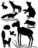 Silhouettes of wood animals Stock Photos