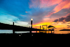 Silhouettes of wooden port on the beach Stock Photos