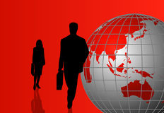 Silhouettes with a World Globe Royalty Free Stock Photo