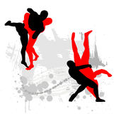 Silhouettes of wrestlers Stock Images