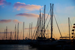 Silhouettes of yachts in a bay at sunset Royalty Free Stock Images