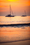 Silhouettes of yachts at sunset. Silhouettes of boats at sunset in the sea, Phuket, Thailand Royalty Free Stock Images