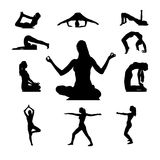 Silhouettes of Yoga positions Stock Images