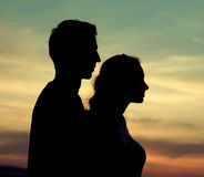 Silhouettes of the young couple royalty free stock image