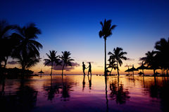 Silhouettes of young couple at scenic sunset Stock Images