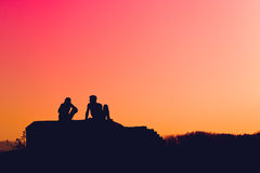 Silhouettes of young love couple Stock Photo