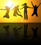Silhouettes of young people Stock Photography