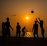 Silhouettes a young people on a beach Stock Image