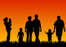 Silhouettes of young people with children Royalty Free Stock Photos