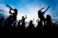 Silhouettes of young people dancing.  Royalty Free Stock Photo