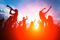 Silhouettes of young people dancing.  Royalty Free Stock Images