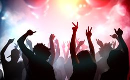 Silhouettes of young people dancing in club. Disco and party concept.  Royalty Free Stock Photo