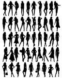 Silhouettes of young pretty women . Royalty Free Stock Photo