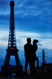 Silhouettes of young romantic couple near the Eiffel tower Stock Image