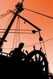 silhouettesolnedgång för kapten s Royaltyfri Bild