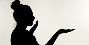 Silhouetthe of the surprised woman stock images