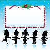 silhouettiert Weihnachtskinder mit Schild Lizenzfreie Stockbilder