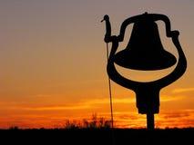 Silhouettiertes Abendessen Bell Stockfoto