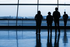 Silhouetts of people waiting at the airport Stock Photography