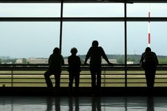 Silhouetts of people waiting at the airport Stock Photos