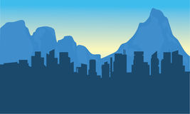 Silhouettte of city and background mountain Royalty Free Stock Photography