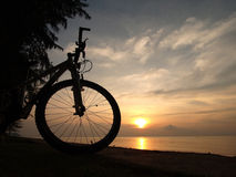 Silhoutte bicycle beside seaside. Mountain bicycle was silhoutte beside sunset seaside Royalty Free Stock Images