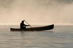 Silhoutte of a canoeist Stock Images