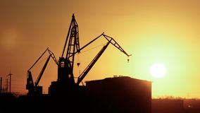 Silhoutte of a Crane in Harbor of Hamburg. In the morning Stock Photos