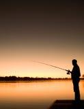silhoutte di pesca Immagine Stock Libera da Diritti