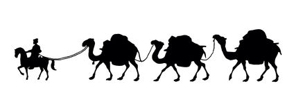 Silhoutte eines Kamelwohnwagens Stockbilder