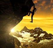 Silhoutte of girl climbing on rock at sunset. In the background Gabelhorn - Swiss stock image