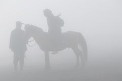 Silhoutte of the Horseback Ride Stock Photography