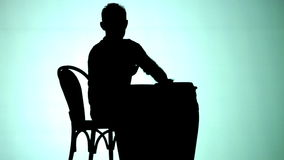 Silhoutte of Man playing drums stock footage