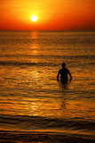 Silhouette at sunrise. Silhouette during sunrise at the edge of the sea Royalty Free Stock Images