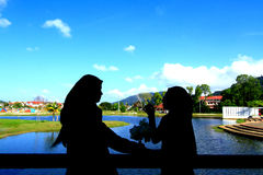 Silhoutte of two Muslim girl Stock Image