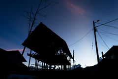Silhoutte of wooden house under construction Stock Photos