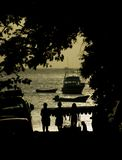 Silhoutted Women Walking To The Beach Stock Photography
