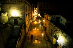 Silhouttes walking along the chrismas decorated cobbled streets of Zadar at night, Croatia stock images