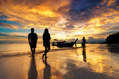 Silhueate of people with sunset background. Royalty Free Stock Image