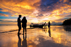 Silhueate of people with sunset background. Stock Images