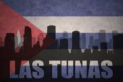 Silhueta abstrata da cidade com texto Las Tunas na bandeira do cubano do vintage ilustração royalty free