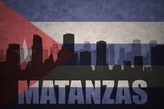Silhueta abstrata da cidade com texto Matanzas na bandeira do cubano do vintage ilustração do vetor