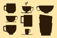 Silhueta castanho chocolate do copo de café na ilustração amarela do fundo Foto de Stock Royalty Free